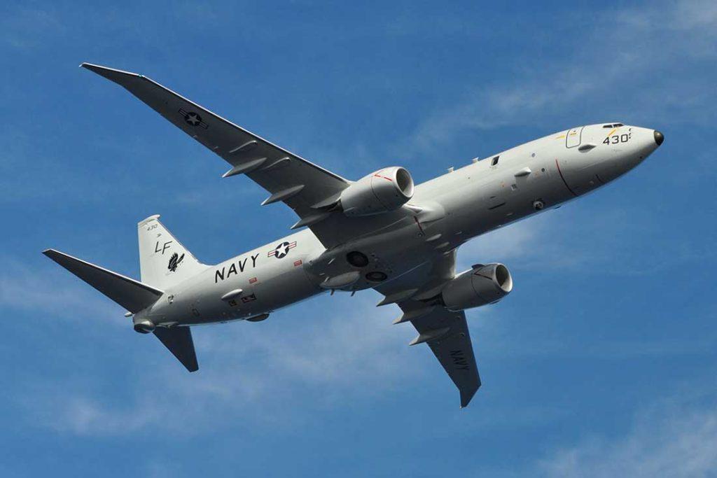Over-the-Baltic-Sea-a-Russian-Su-27-Intercepts-a-U.S.-Reconnaissance-Plane-P-8A-Poseidon