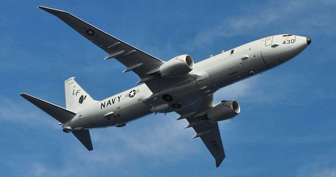 Over-the-Baltic-Sea-a-Russian-Su-27-Intercepts-a-U.S.-Reconnaissance-Plane-P-8A-Poseidon