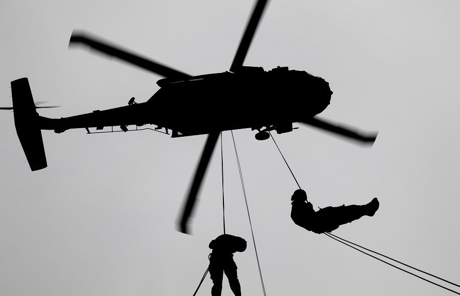 Service Members Participate in Helicopter Rappel and Sling Load Training