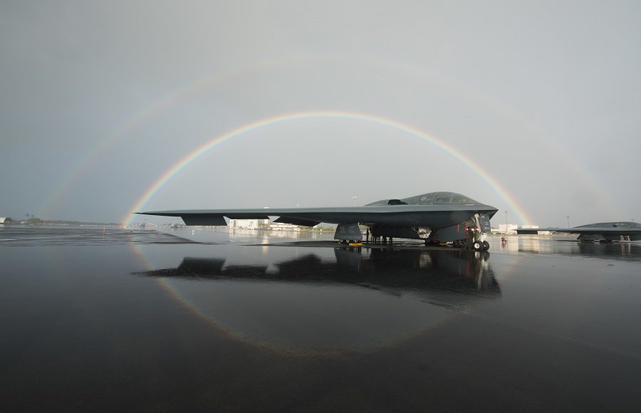 B-2 parked on flightline under a double rainbow in Hawaii
