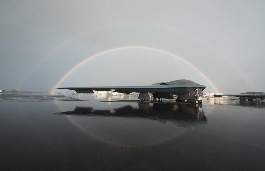 B-2 parked on flightline under a double rainbow in Hawaii